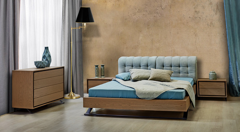 Wooden bedroom with metal legs and fabric on the back